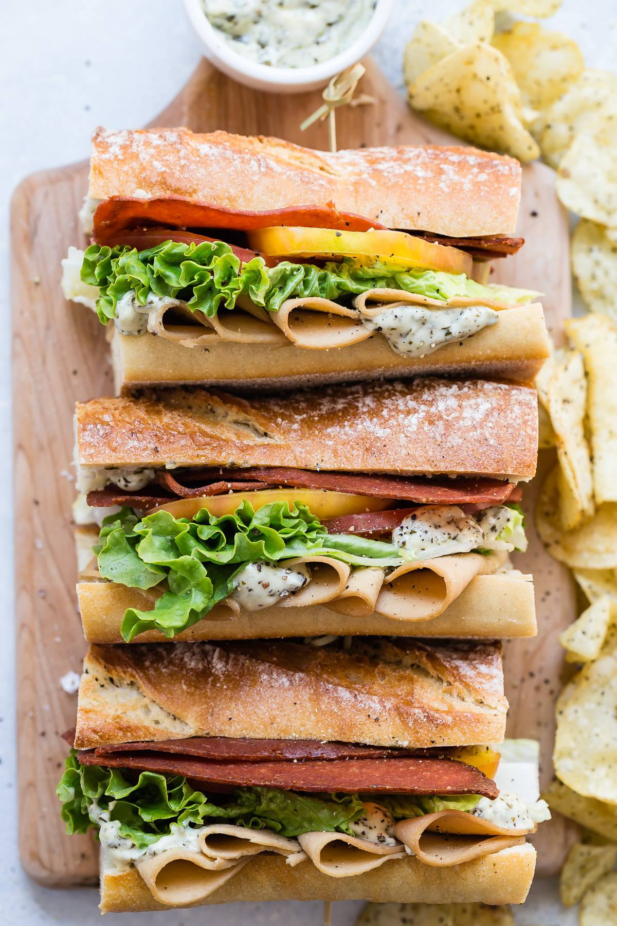 A tasty club sandwich with heirloom tomatoes and lettuce