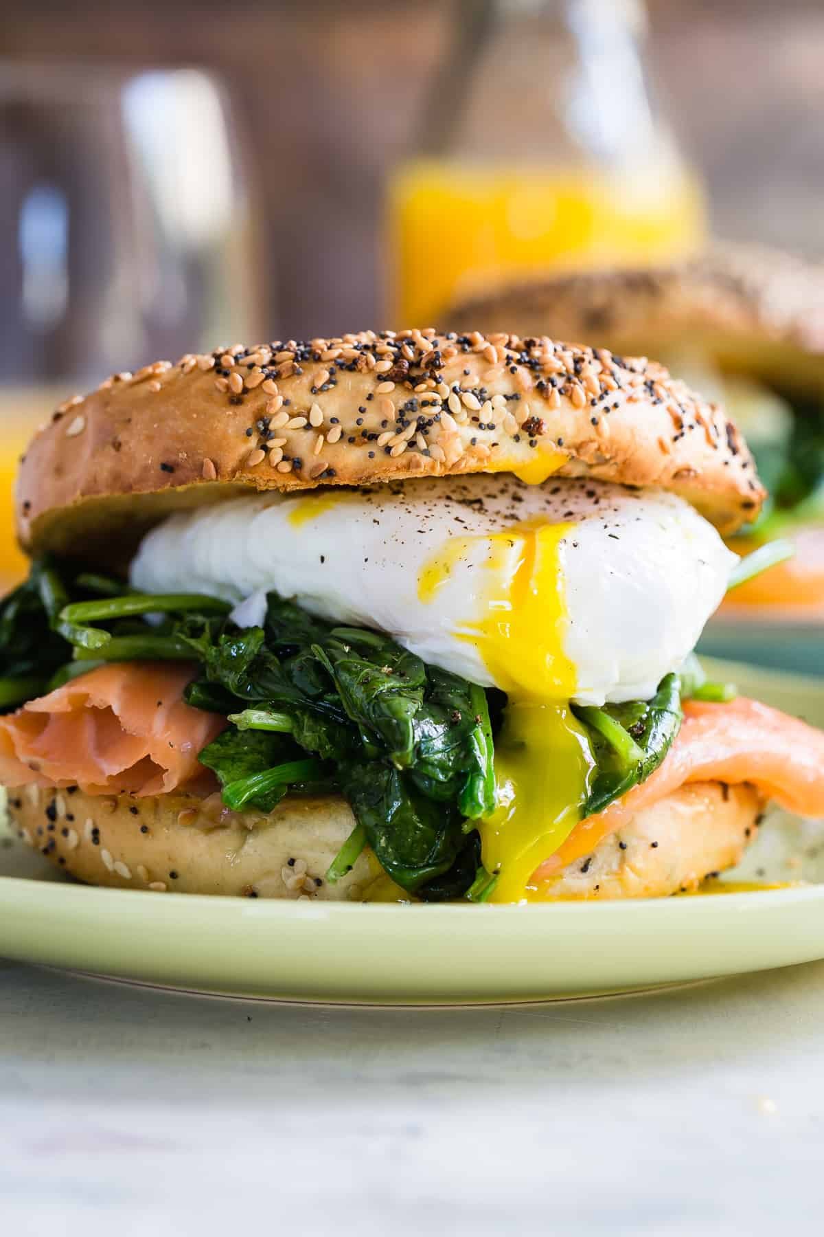 Eggs Florentine bagel loaded with spinach and salmon.