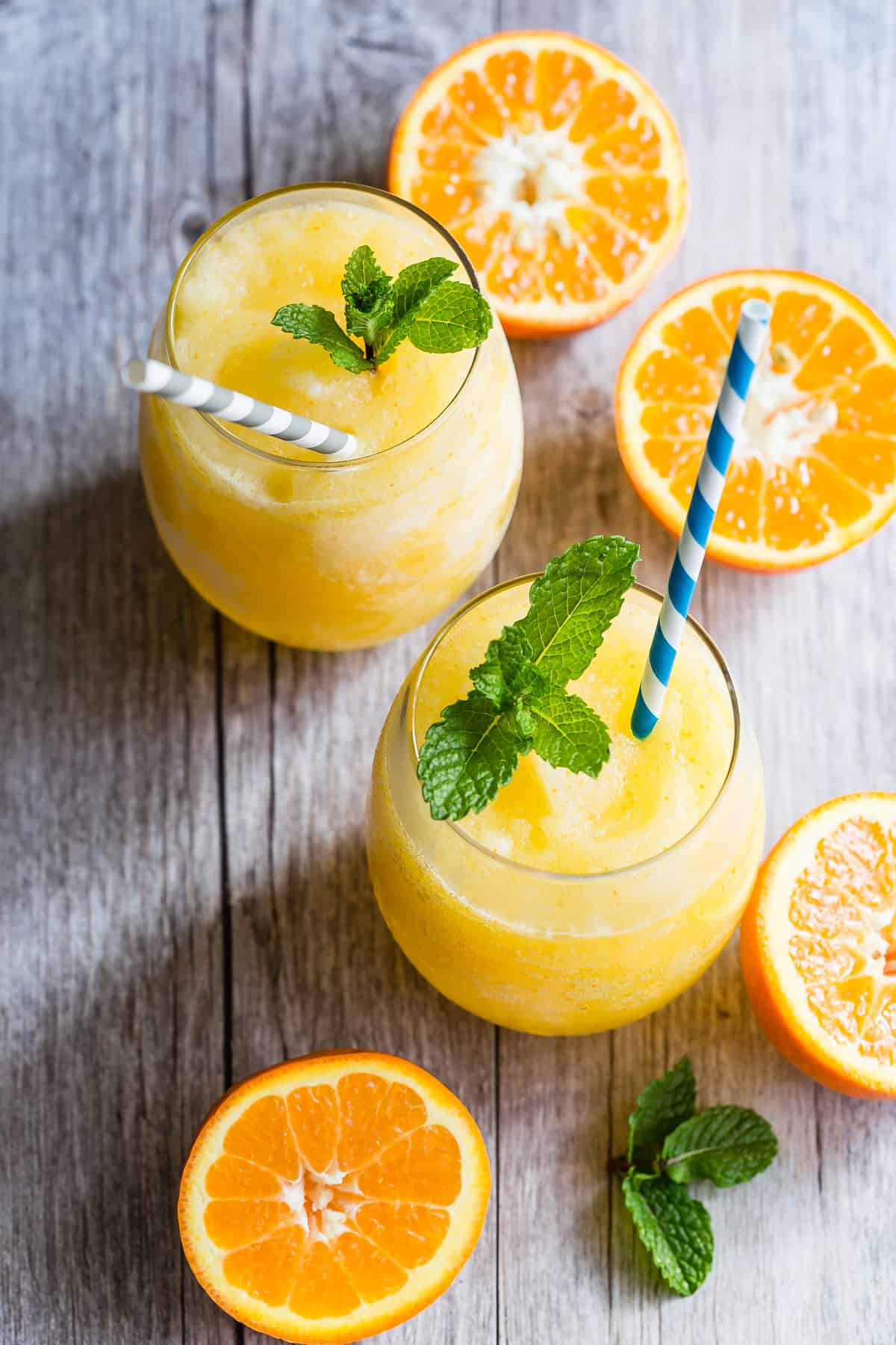 Blended frozen Prosecco with orange and fresh mint!