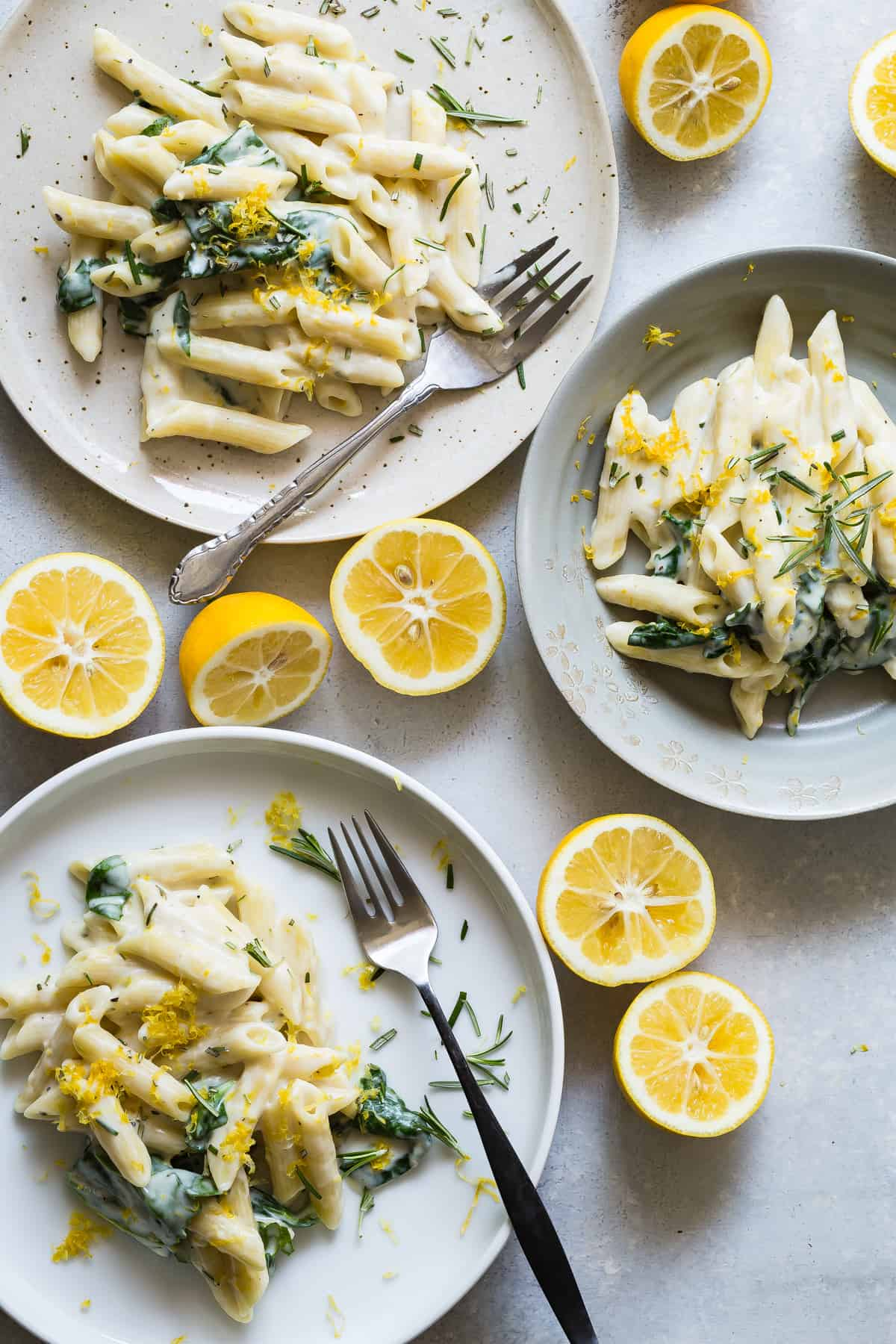 3 plates of penne pasta with creamy goat cheese sauce