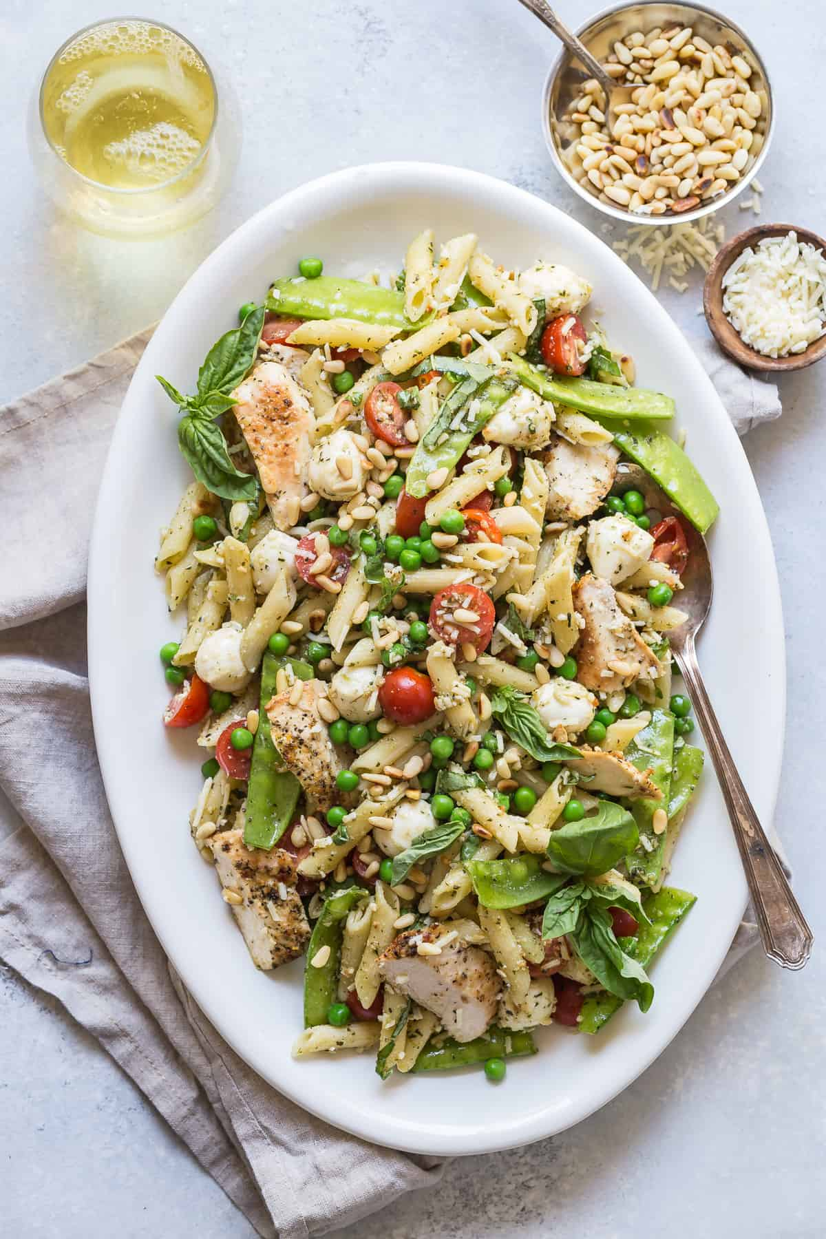 The perfect Pesto Pasta Salad loaded with snap peas, grilled chicken, peas and mozzarella!