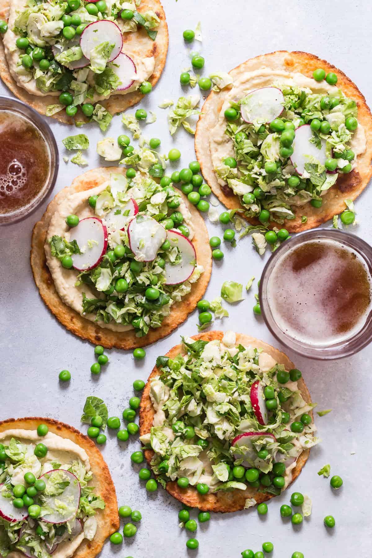 Creamy hummus on crispy tostadas.