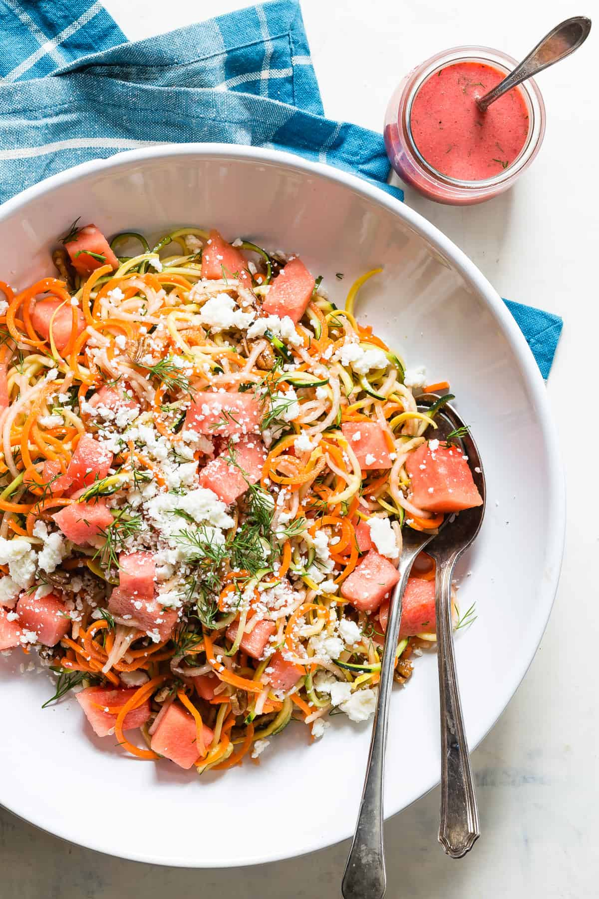 Fresh watermelon salad with spiraled veggies.