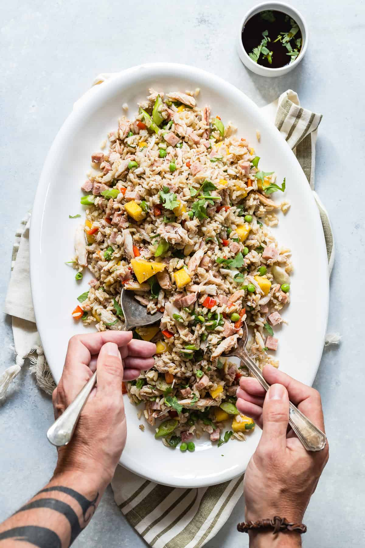Tasty Fried Rice loaded with chunks of crab meat, diced ham and mango for a touch of sweetness. This is a great way to use up any leftover rice!