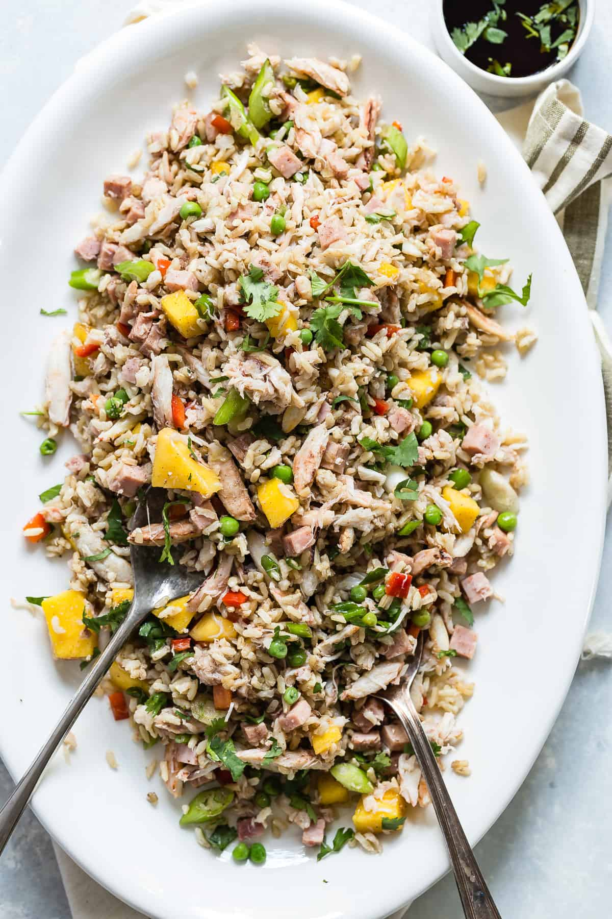 Yummy fried rice packed with crab meat, diced smoked ham, peas and diced mango.