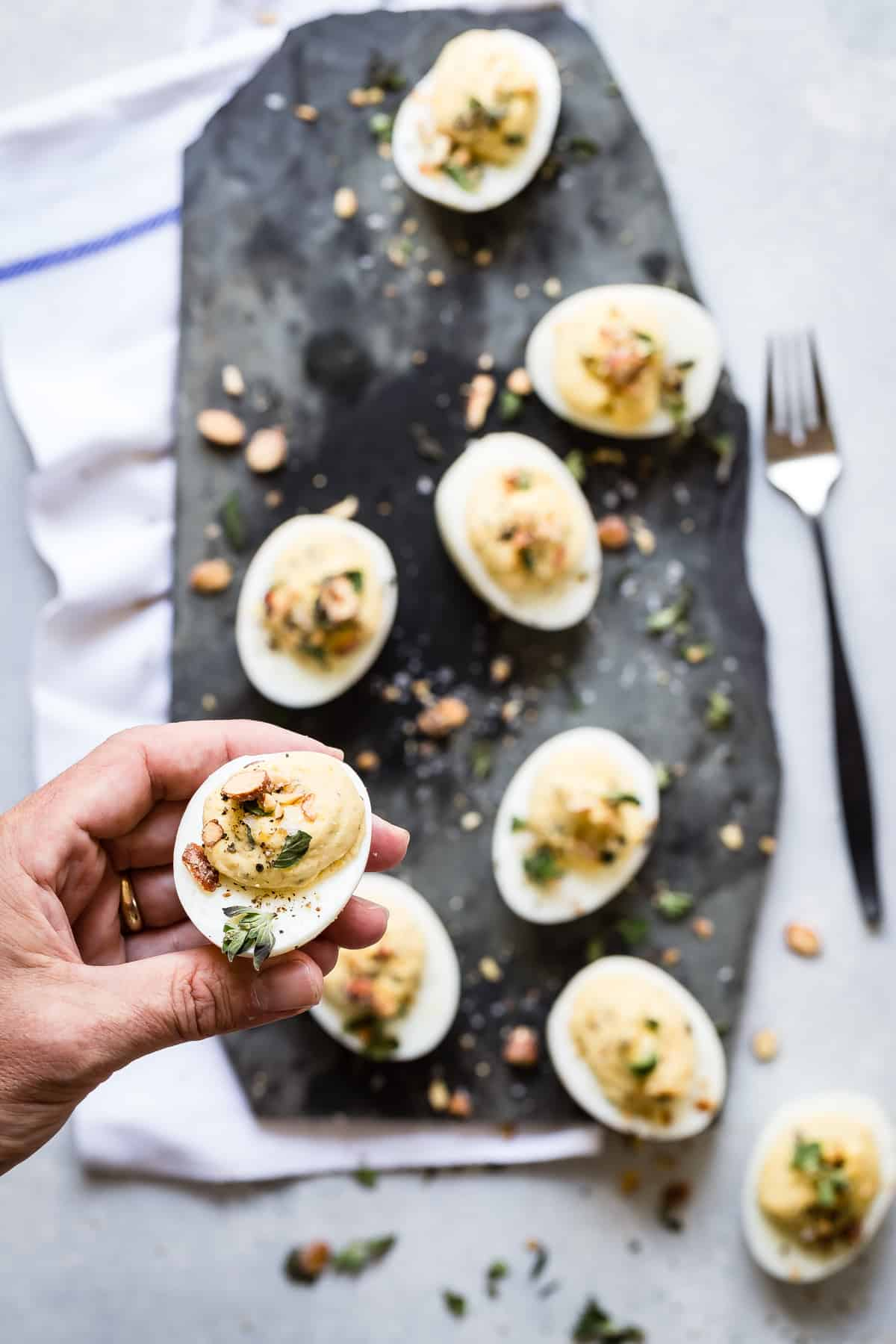 Hummus deviled eggs with fresh oregano