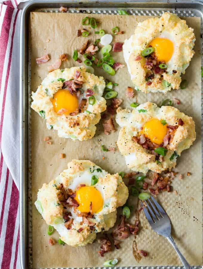 Cloud Eggs with chopped bacon and grated Gruyere cheese. These are so good and easy to make for breakfast!