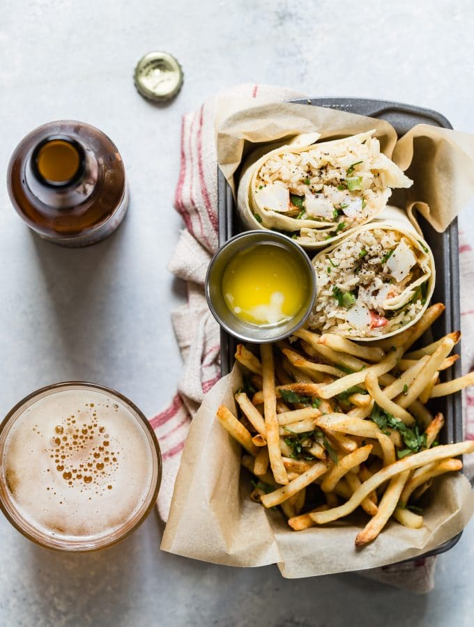 Epic lobster burrito with rice, fresh herbs and melted butter for dipping. Serve with crispy french fries and an ice cold beer for an awesome lunch!
