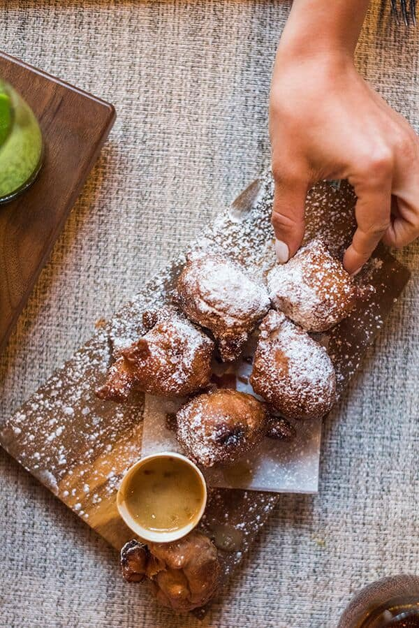 Bacon Beignets with salted caramel sauce from Villard, NYC