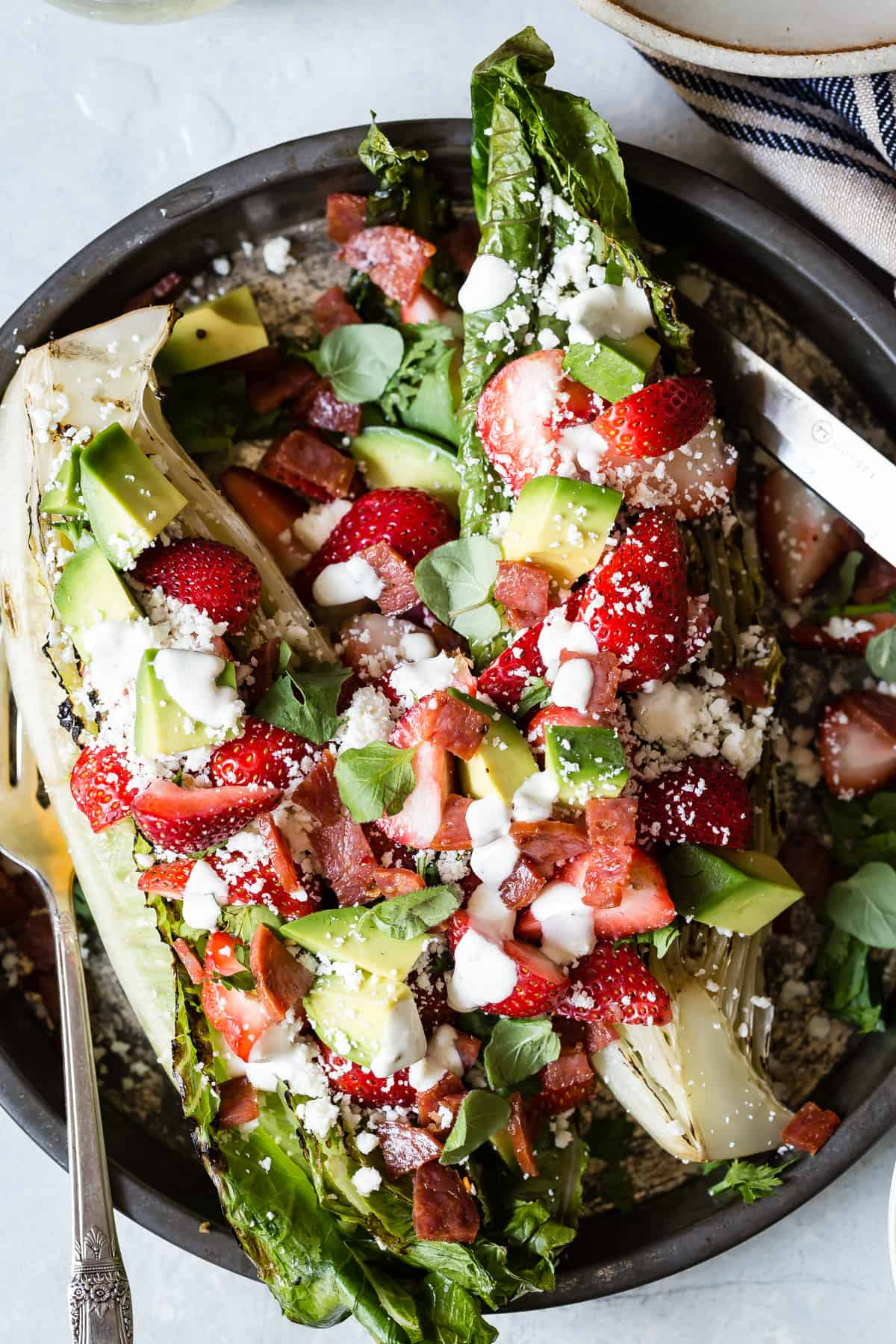 A healthy and light summer lunch strawberry salad loaded with avocado and crispy salami!