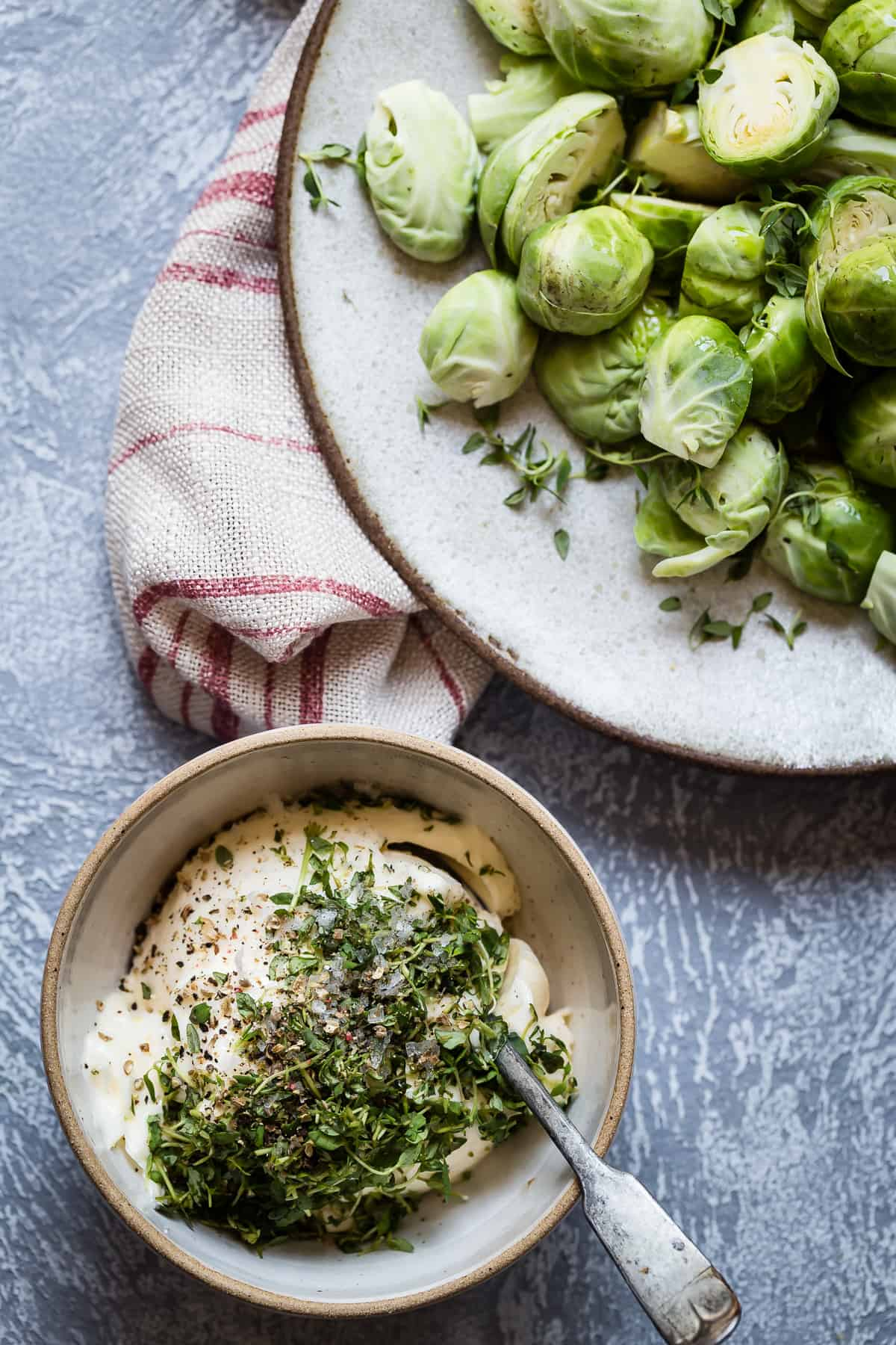 Fresh thyme, salt and black pepper is the perfect seasoning for this buttery spread and roasted brussels sprouts