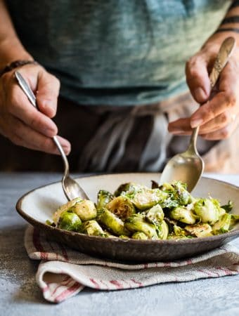 Delicious roasted brussels sprouts tossed in a buttery fresh thyme spread!