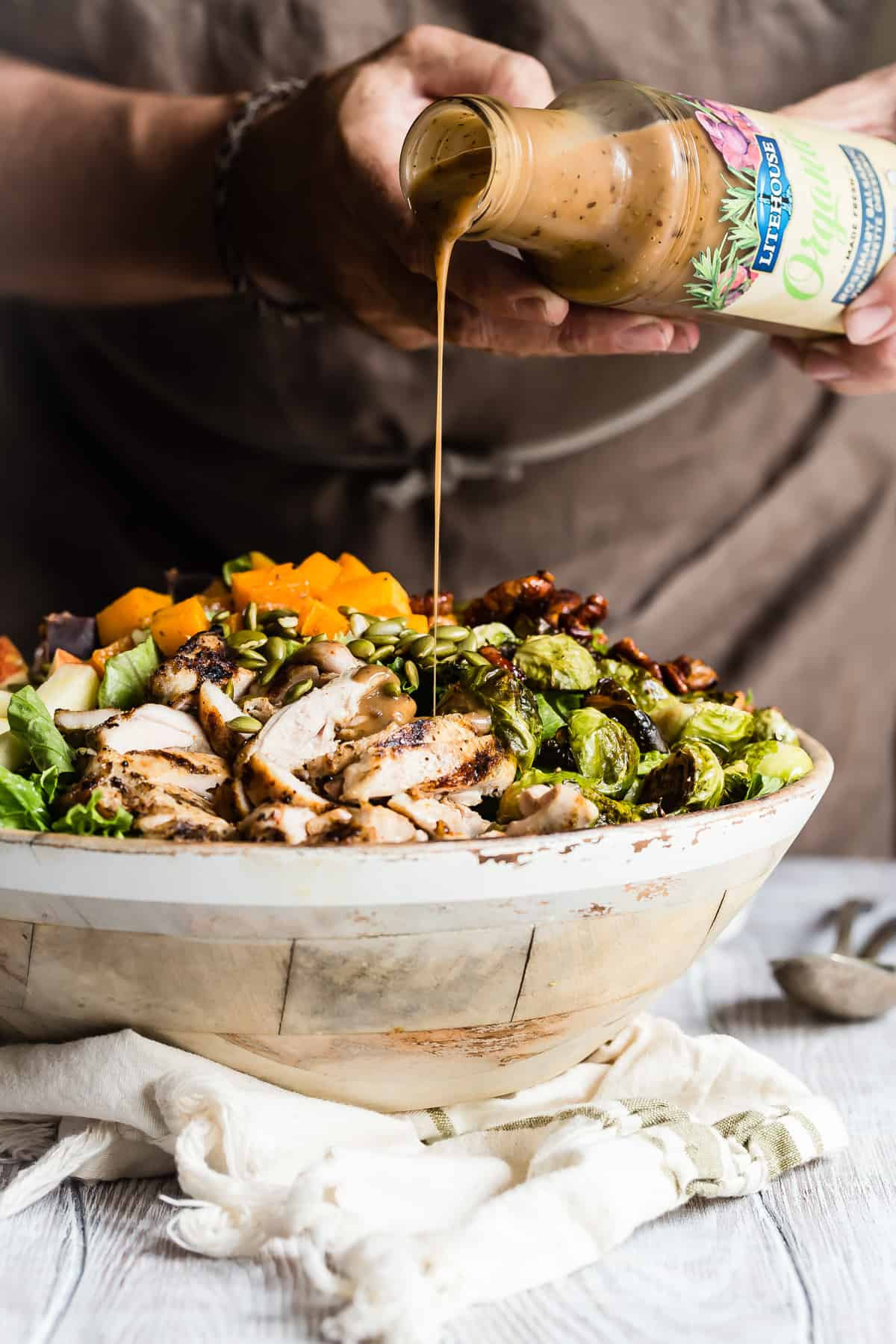 Epic fall salad tossed in a balsamic rosemary dressing