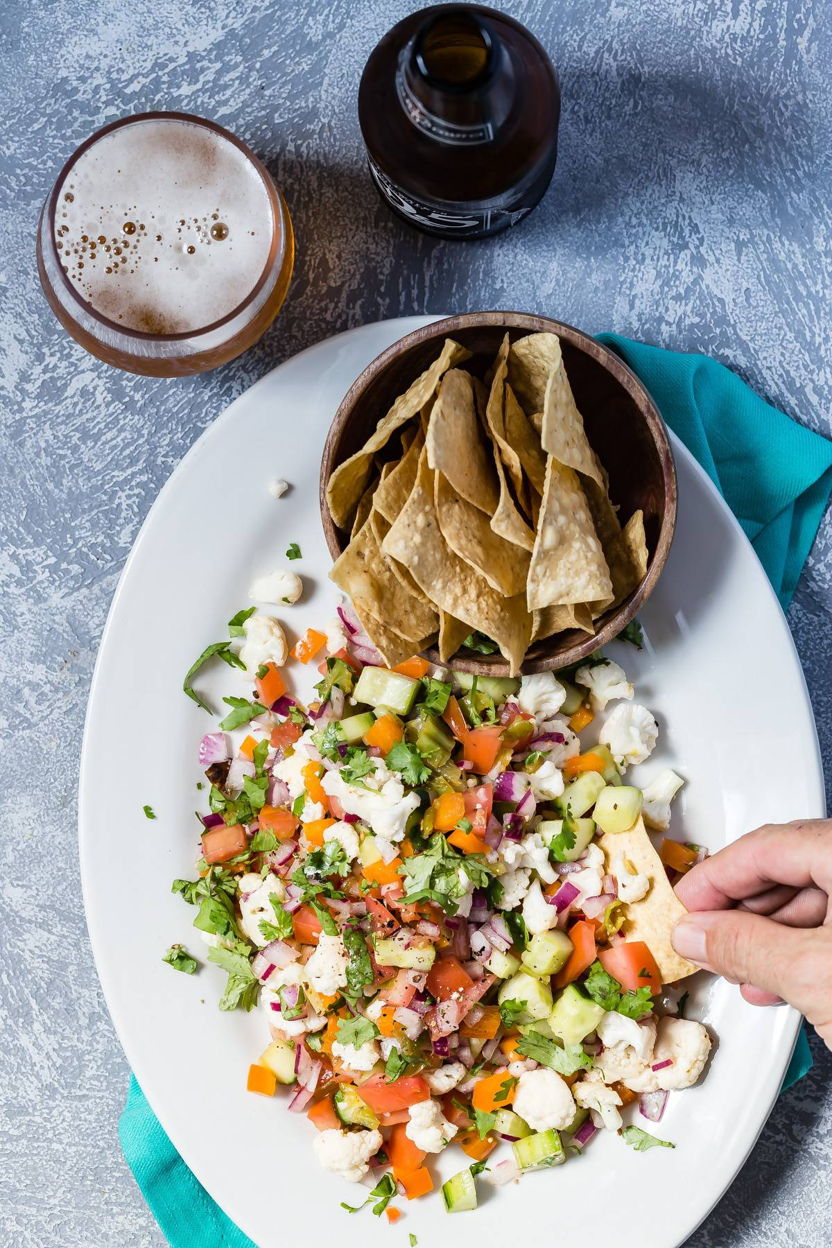 A huge plate of vegetarian ceviche with tortilla chips and an ice cold beer!
