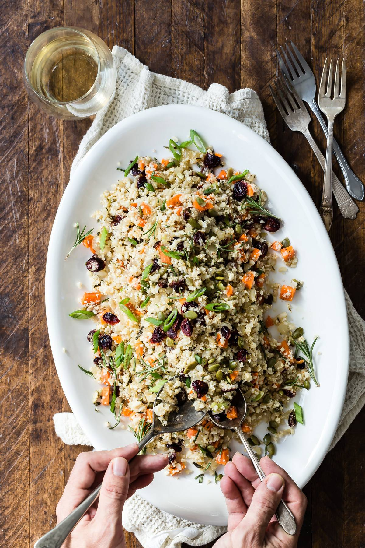 Tasty vegetarian side dish made with cauliflower rice, cranberries and pumpkin seeds! Take this to your Thanksgiving or friends giving celebration!