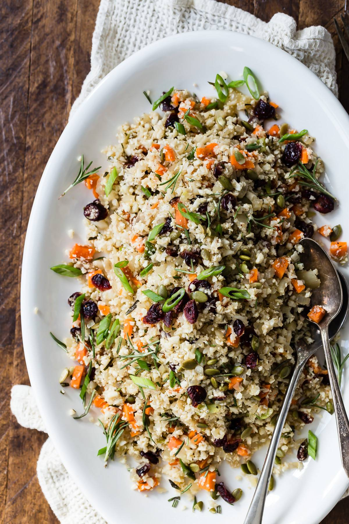 Tasty vegetarian side dish made with cauliflower rice, cranberries and pumpkin seeds! Take this to your Thanksgiving or friends giving celebration! #thanksgiving #vegetarian
