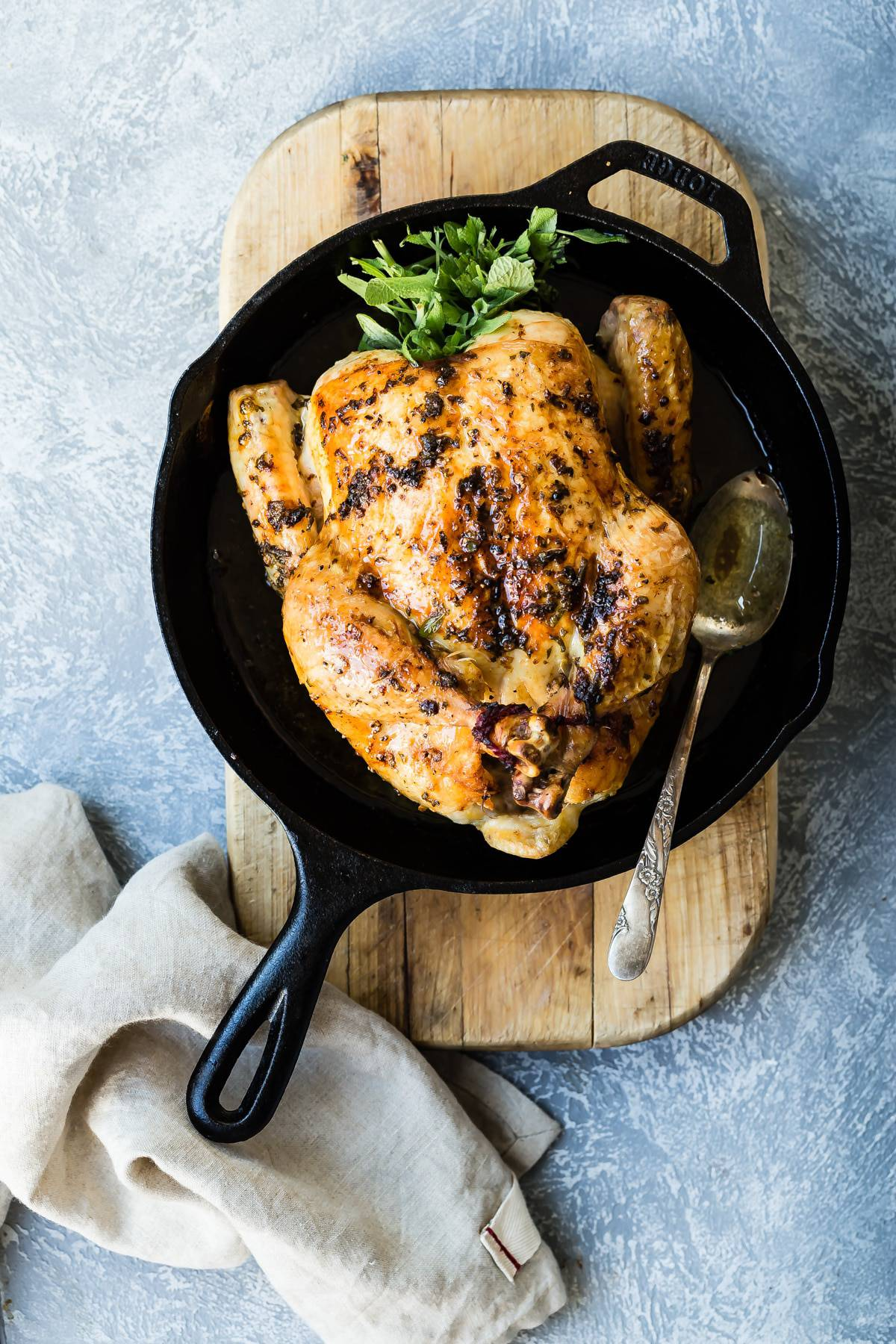 Make this juicy roast chicken covered in a buttery sage spread for dinner! It's so easy, healthy and everyone will love it! #roastchicken #familystyle #familydinners #easydinners