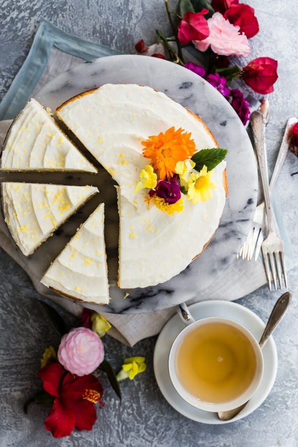 sliced lemon layer cake with edible flowers