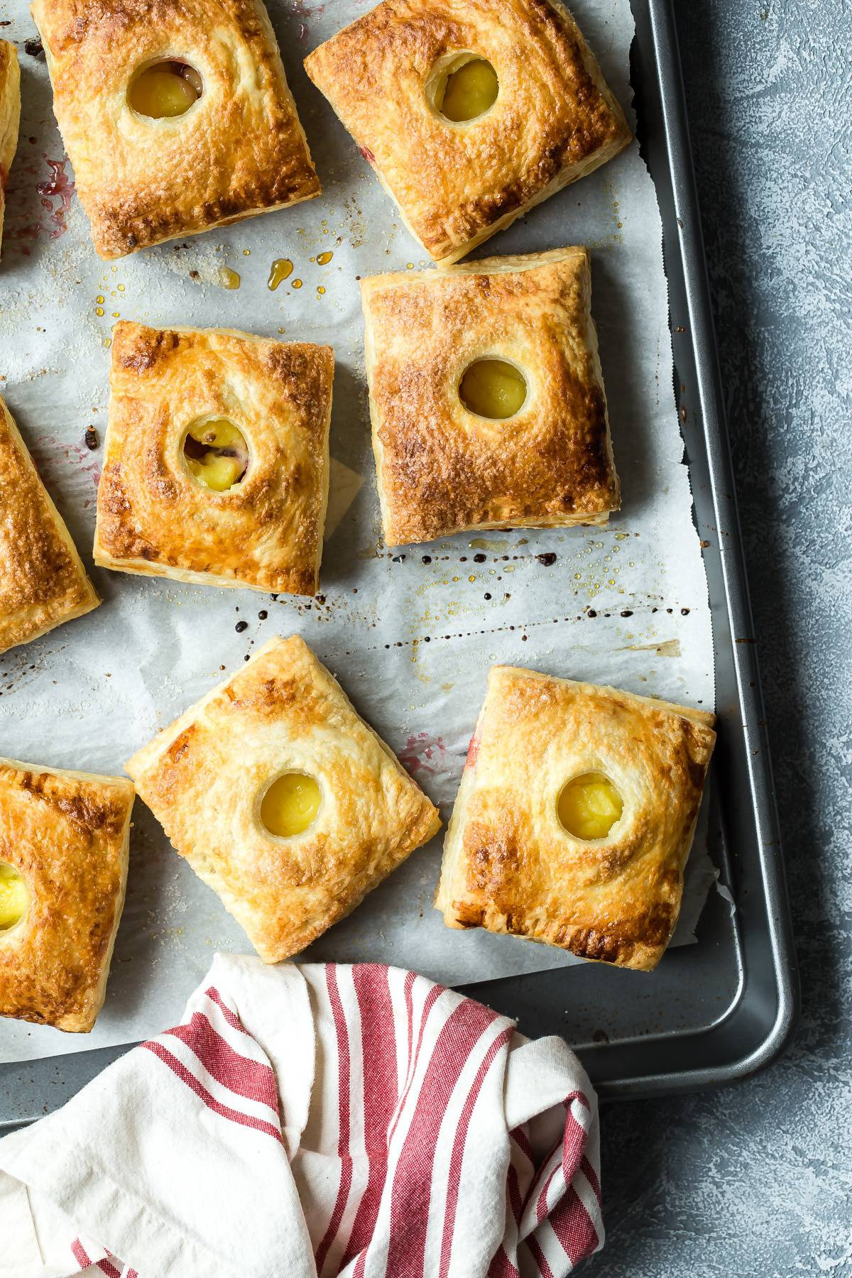Golden flaky pastry hand pies with rhubarb and custard