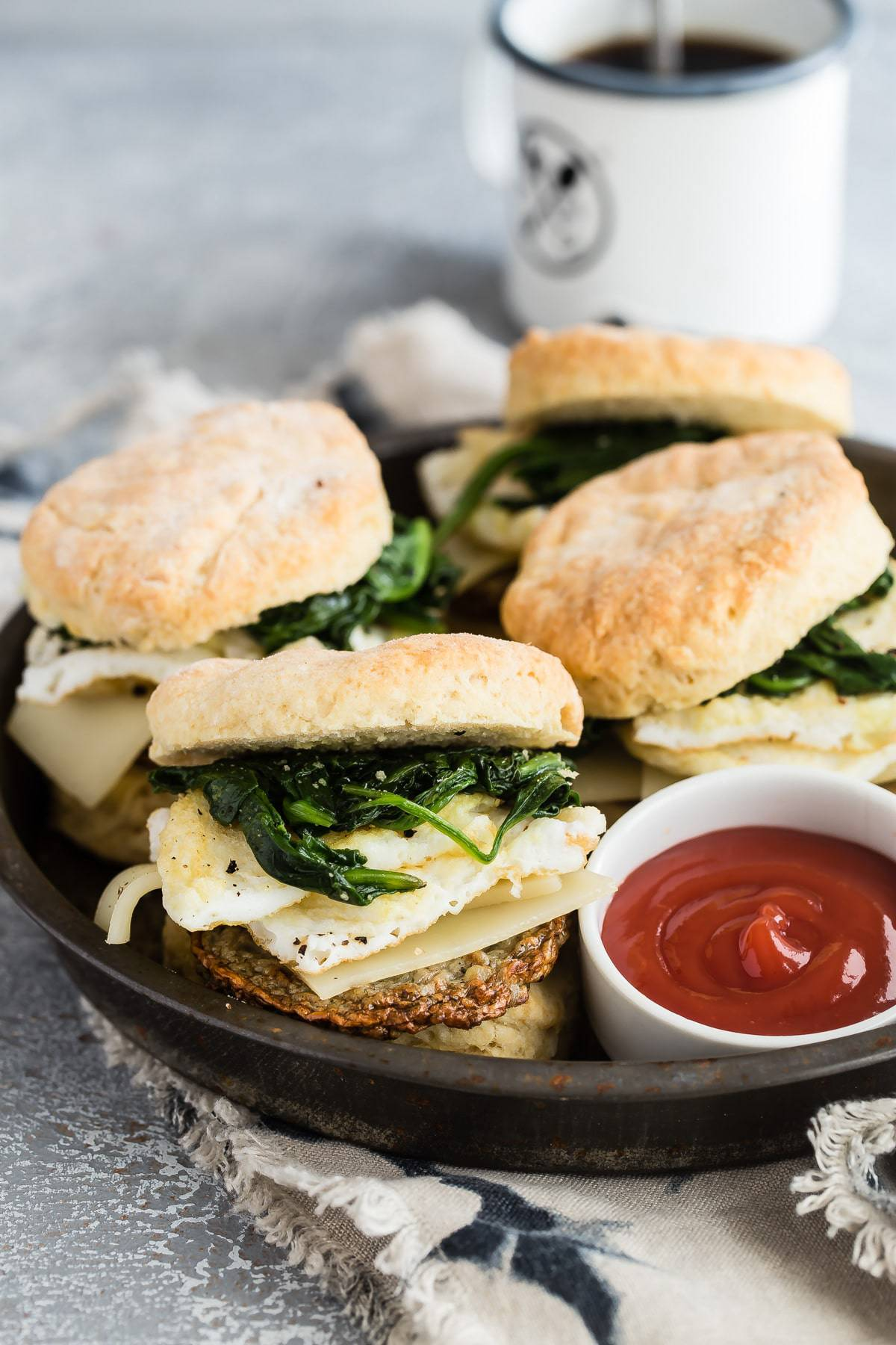 Tasty breakfast biscuit with egg white and spinach