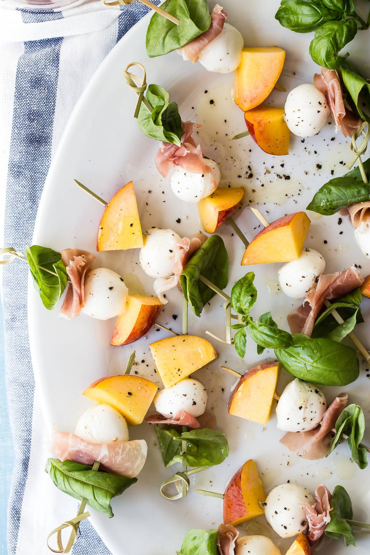 Peach skewers with basil, prosciutto and mozzarella