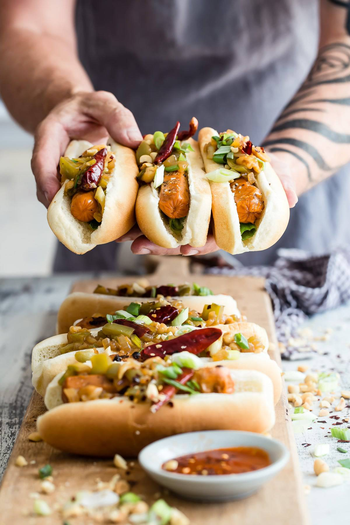 Yummy grilled veggie hotdogs topped with a slightly spicy kung pao mixture! These are so good and you'll love the topping! #veggie #hotdogs #vegetarian #grilling #spicy #foodnessgracious #lightlife