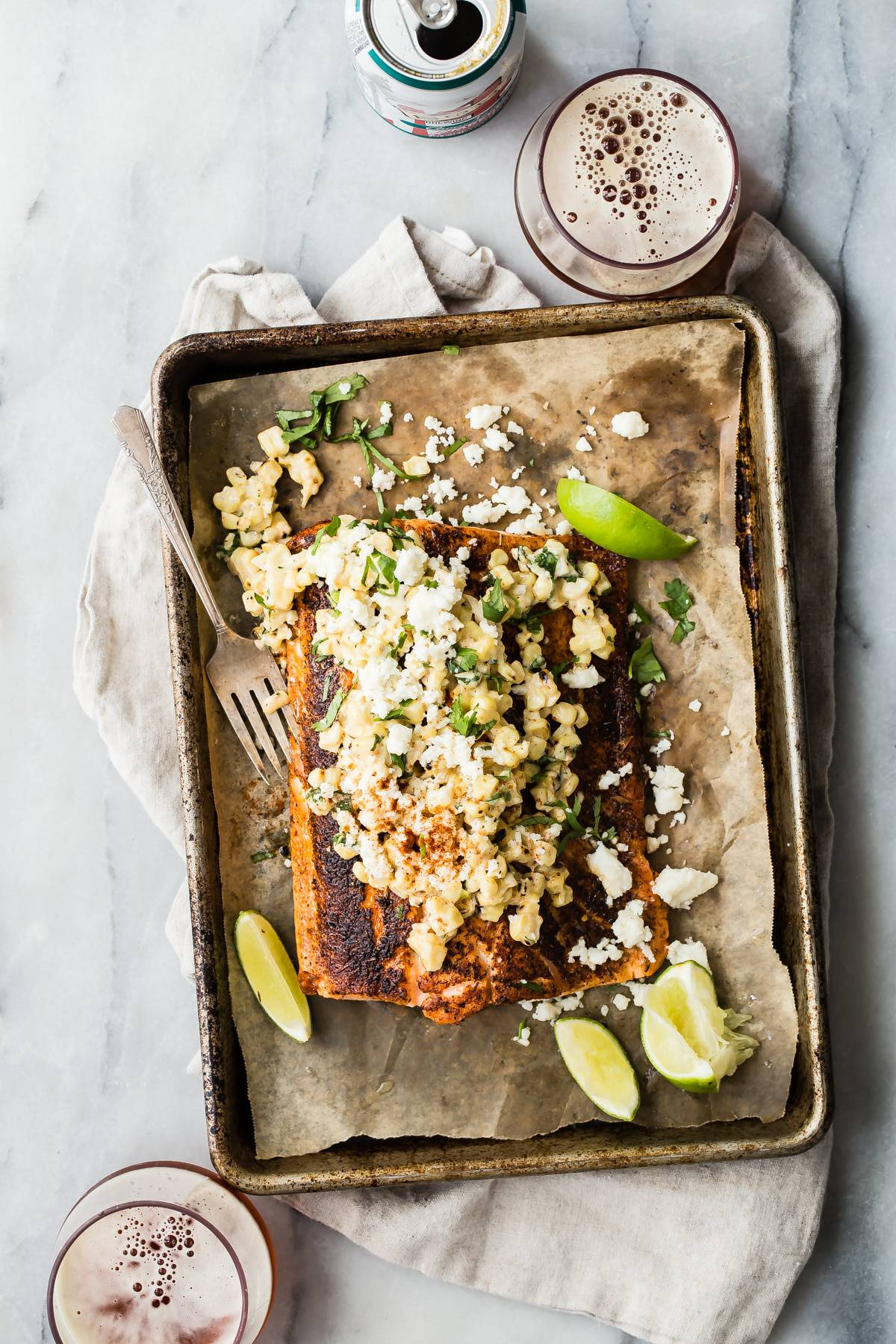 A delicious and juicy blackened salmon filet topped with creamy Mexican style street corn. This is an easy way to feed the family or a crowd of hungry friends! #salmon #dinner #familyrecipes