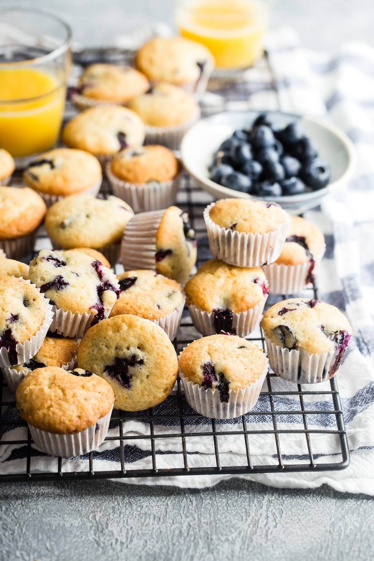 mini blueberry muffins on a wire rack