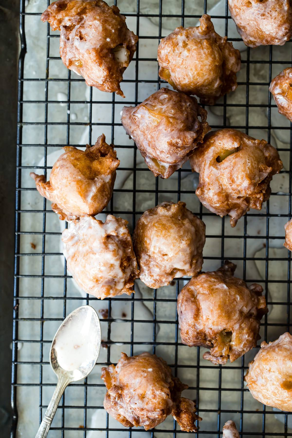 Delicious pumpkin spiced apple fritters drenched in a sweet vanilla glaze! These are so easy to make and so easy to pop more than one in your mouth! #doughnuts #donuts #applefritters #sweets #dessert #foodnessgracious