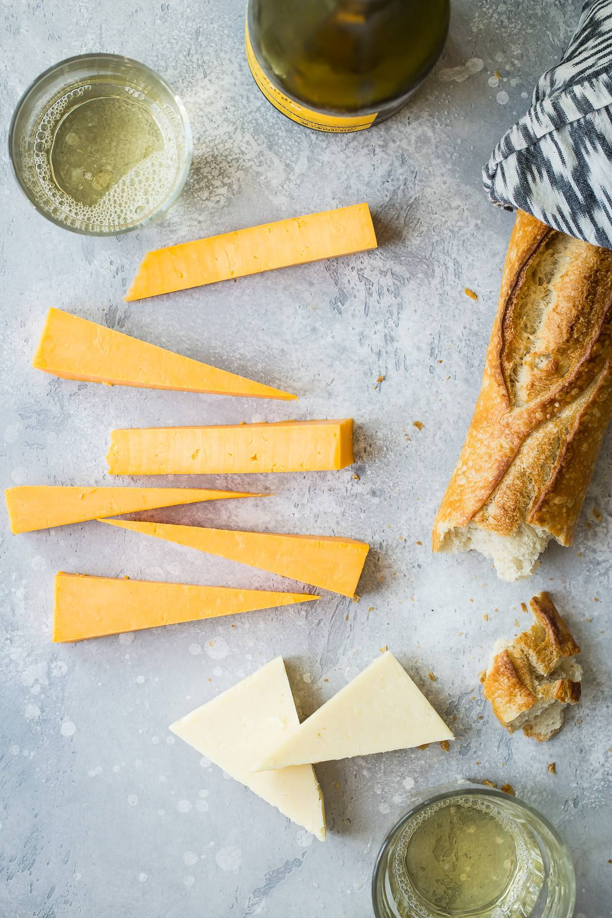Two kinds of cheddar for a cheese board