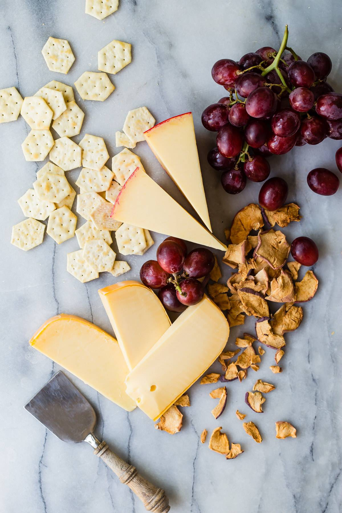 slices of Gouda cheese on a cheese board