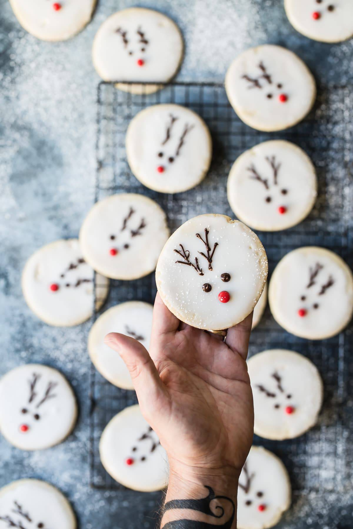 Reindeer cookies on a hand