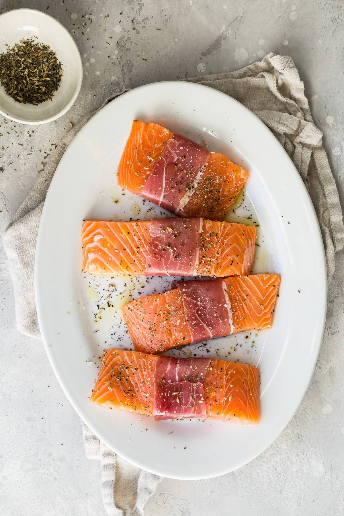 raw salmon on a plate ready to roast