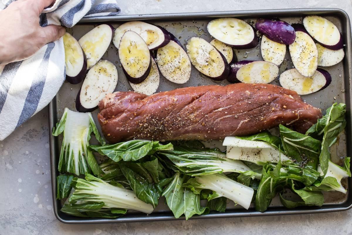 pork tenderloin on a sheet pan with vegetables