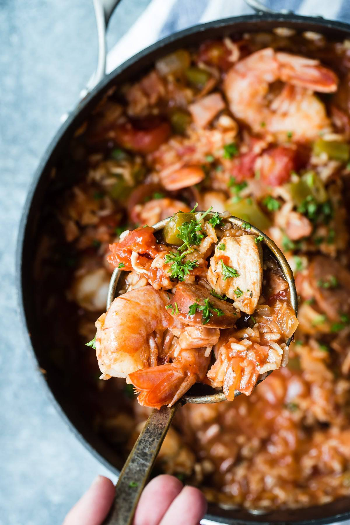Scoop of cajun jambalaya with shrimp