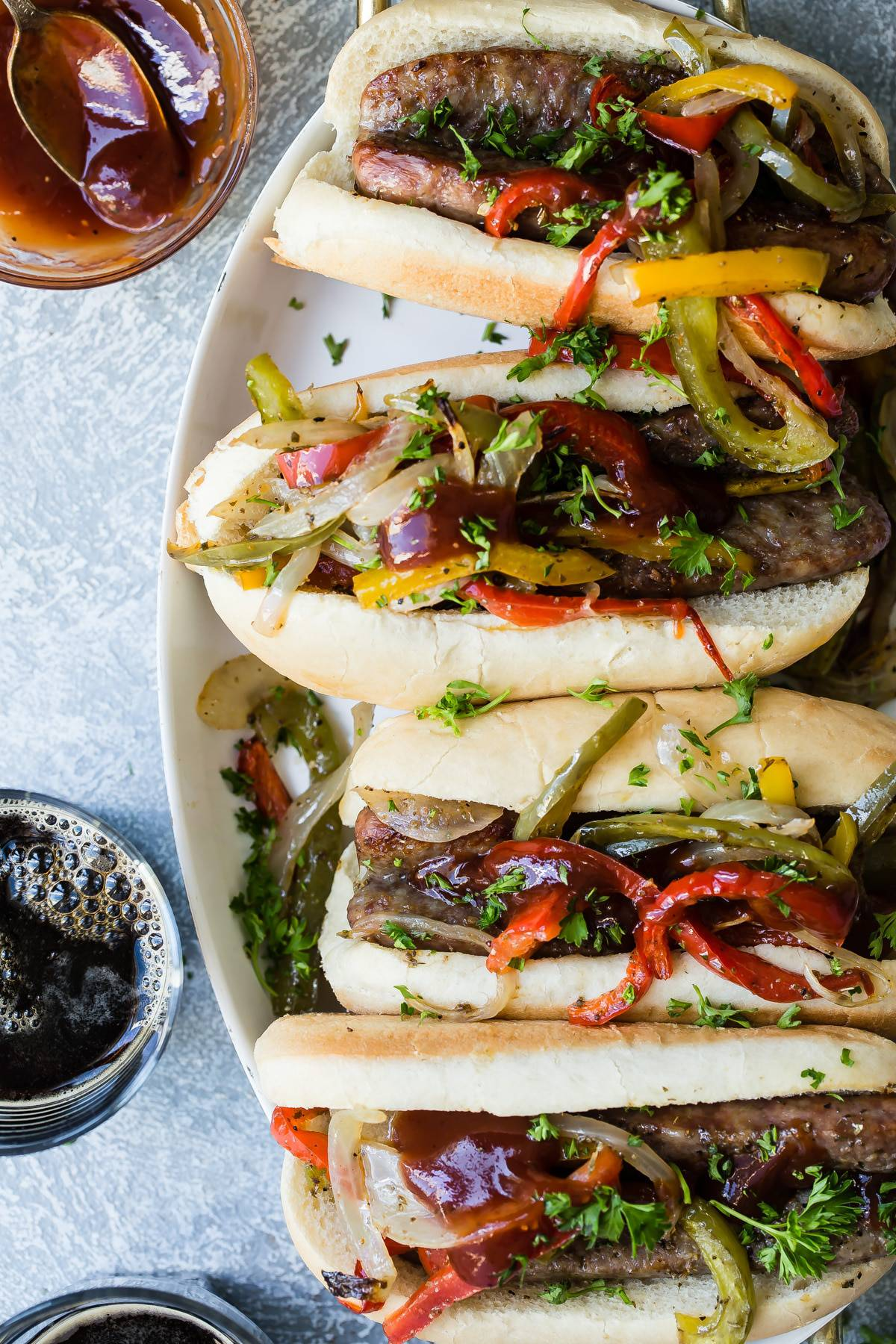 sausage and peppers sandwich on a platter