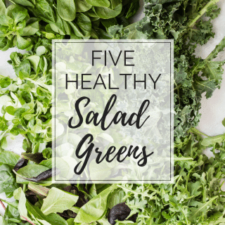 Healthy salad greens on a board