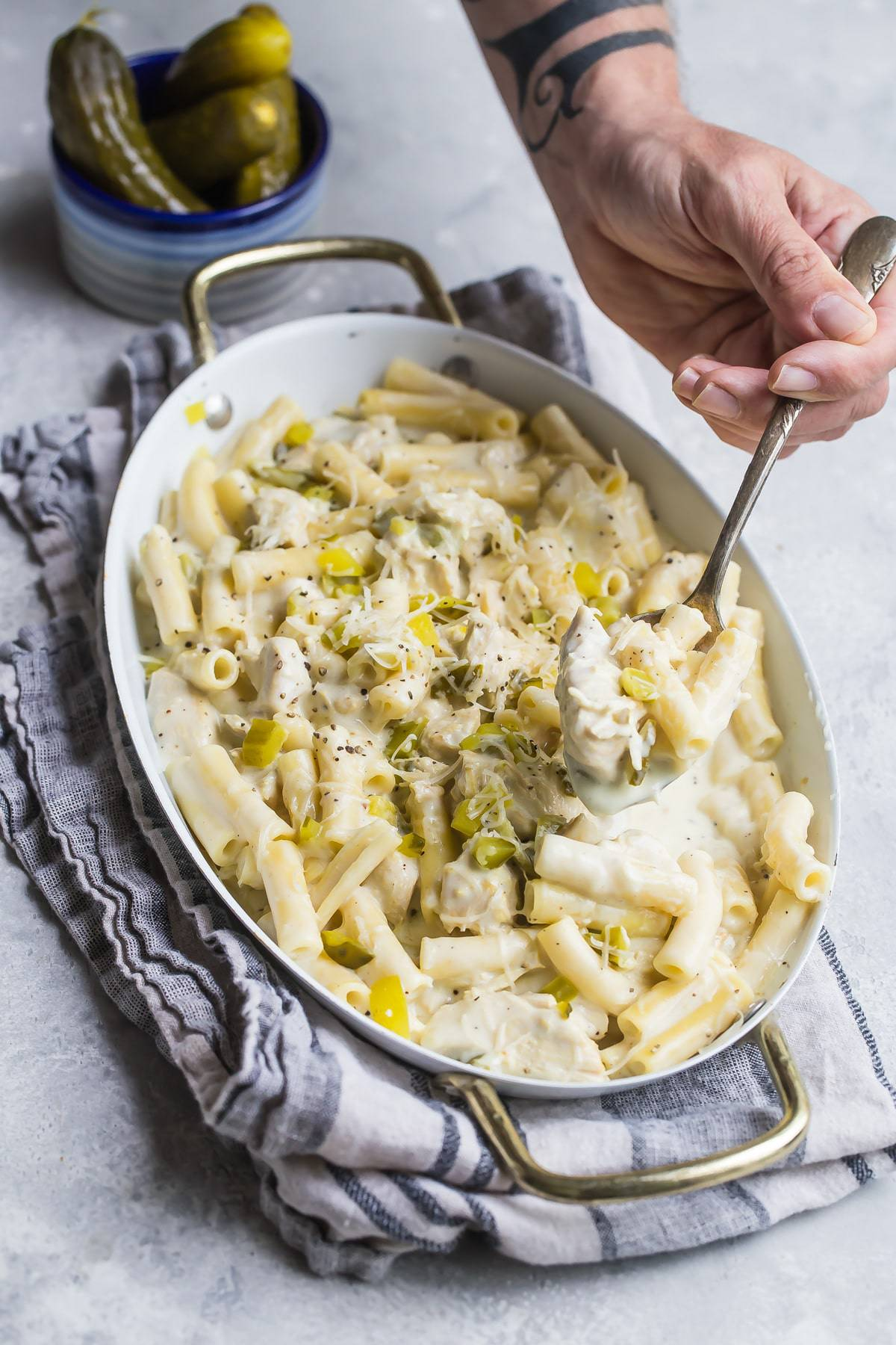 a spoon with dill pickle chicken pasta