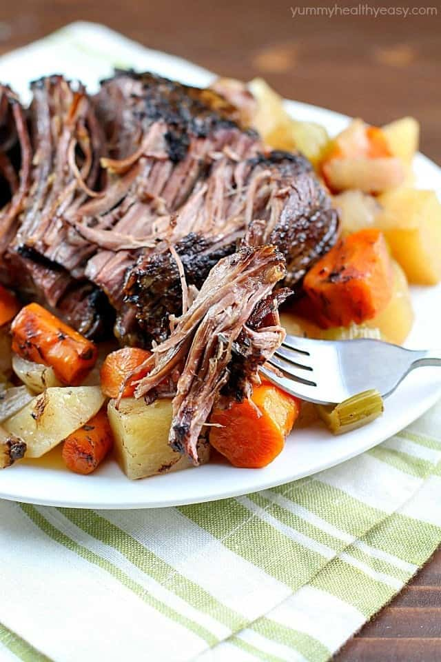 slow cooked beef on a plate with veggies