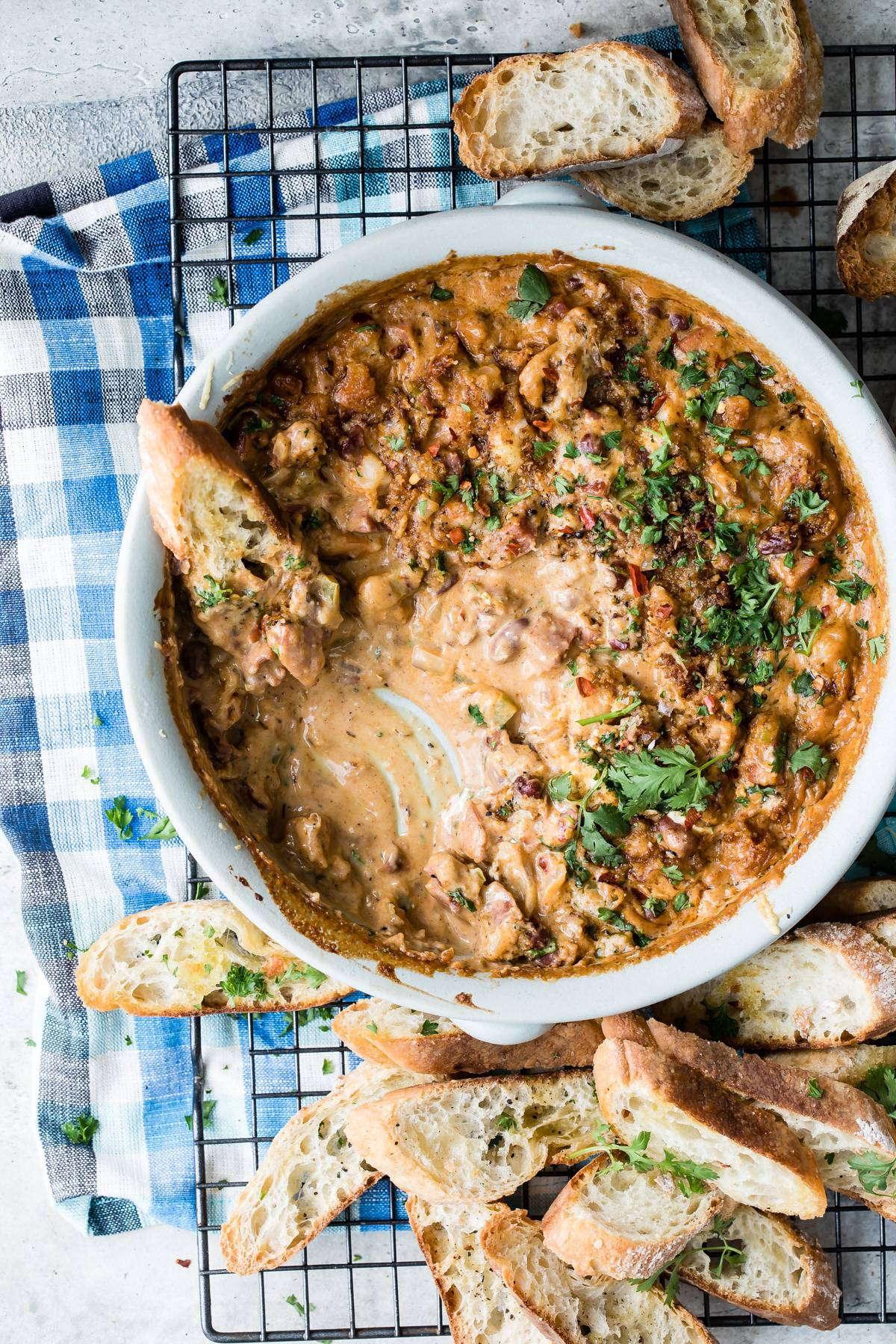 Gumbo dip with bread sticks for dipping