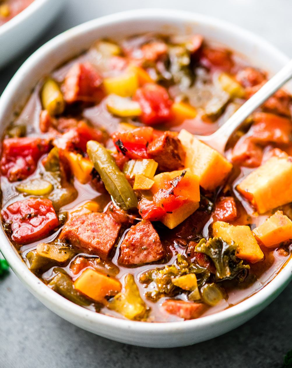 Kale , sausage and peppers in a bowl