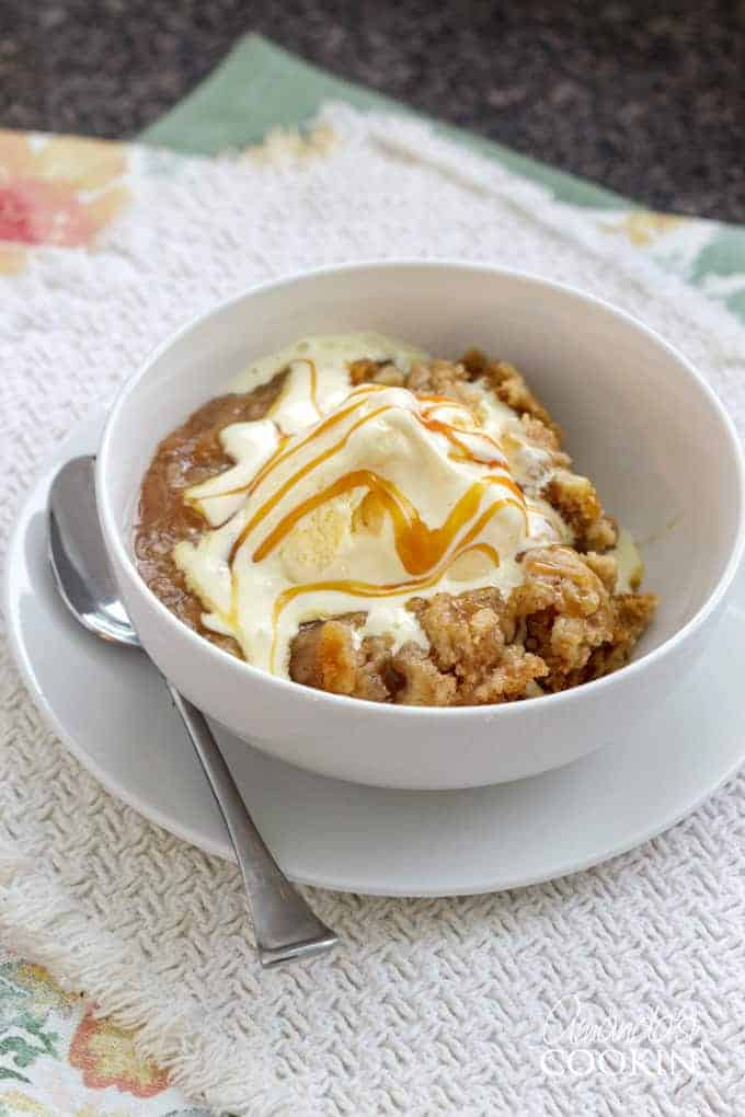 apple cobbler with ice cream in a bowl