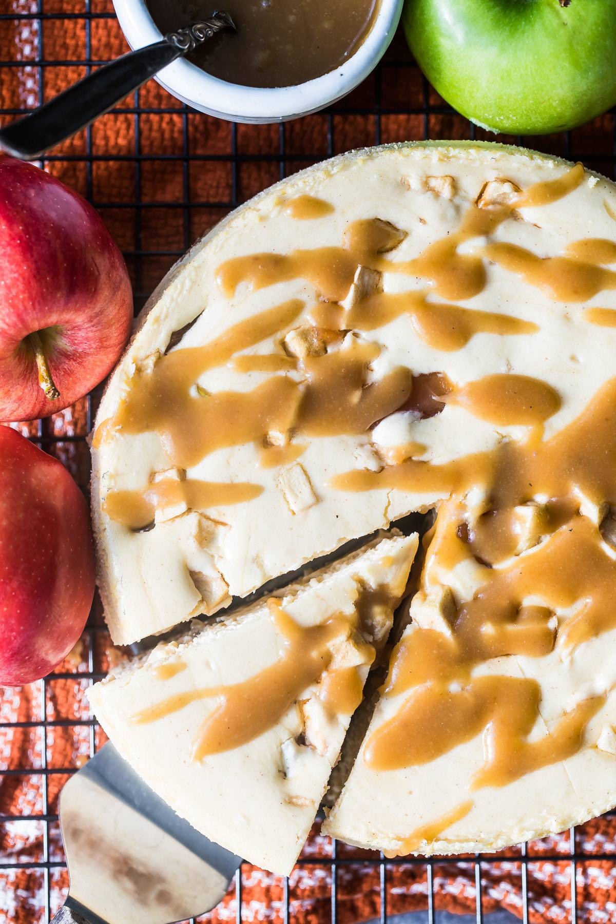 cutting a slice of caramel apple cheesecake