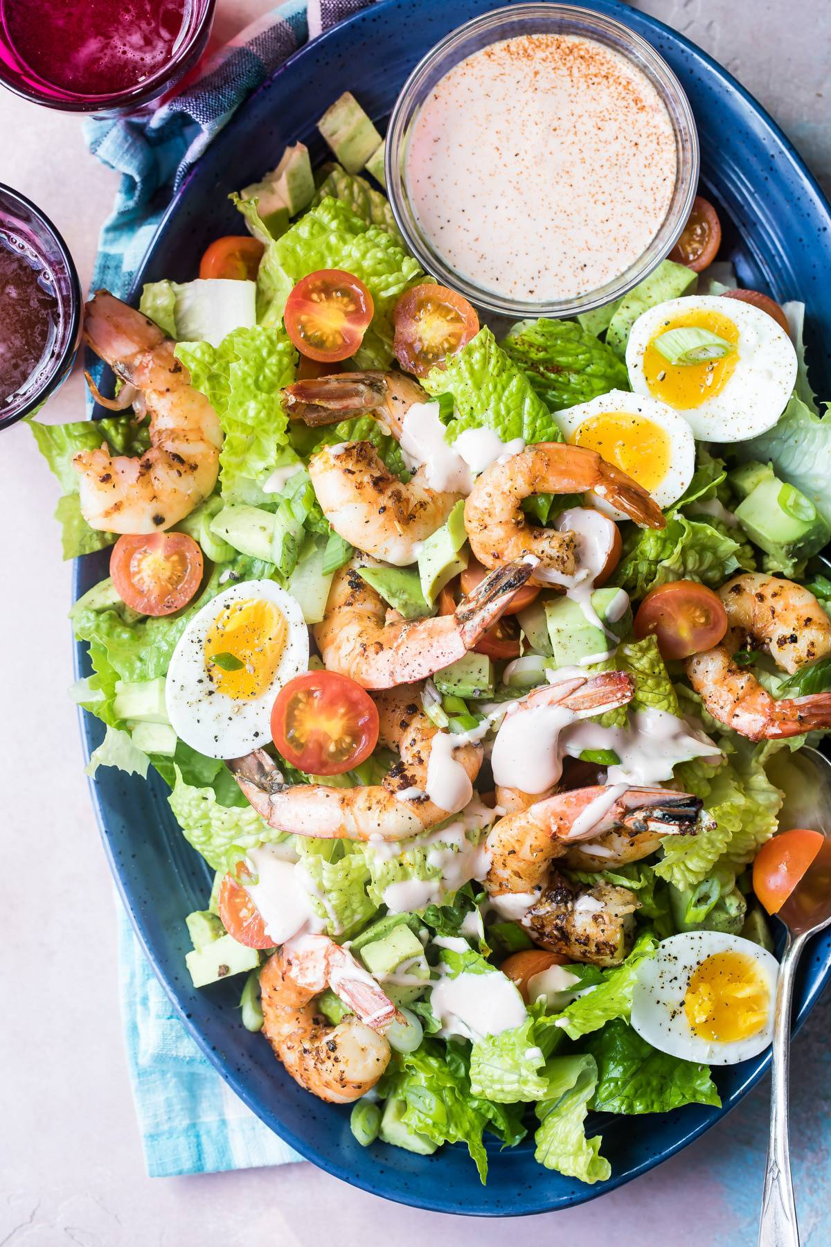 ingredients for a shrimp louie salad on a plate