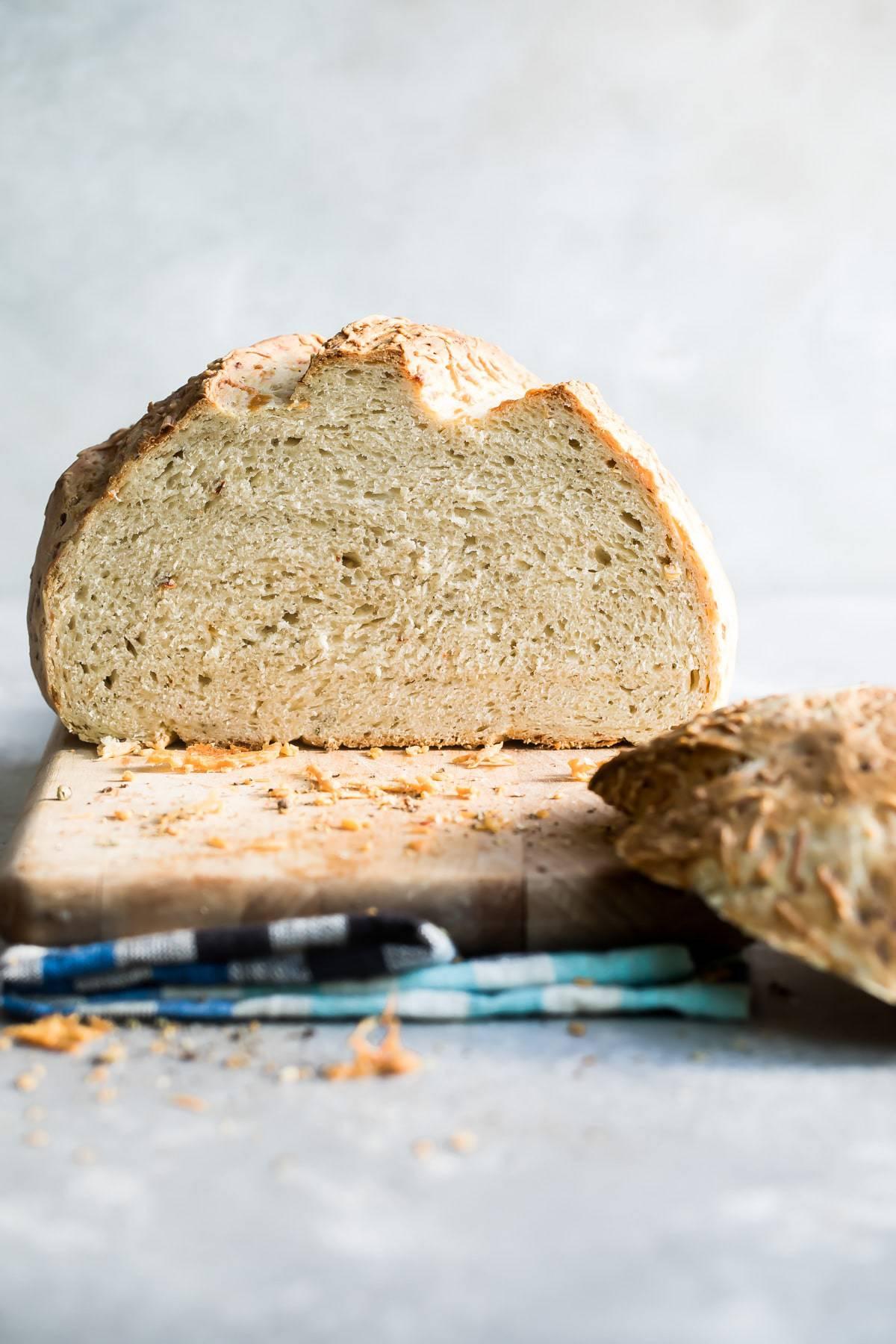 an asiago crusty bread loaf sliced in half
