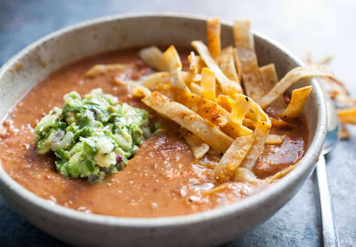 kidney bean soup with tortilla strips and guacamole