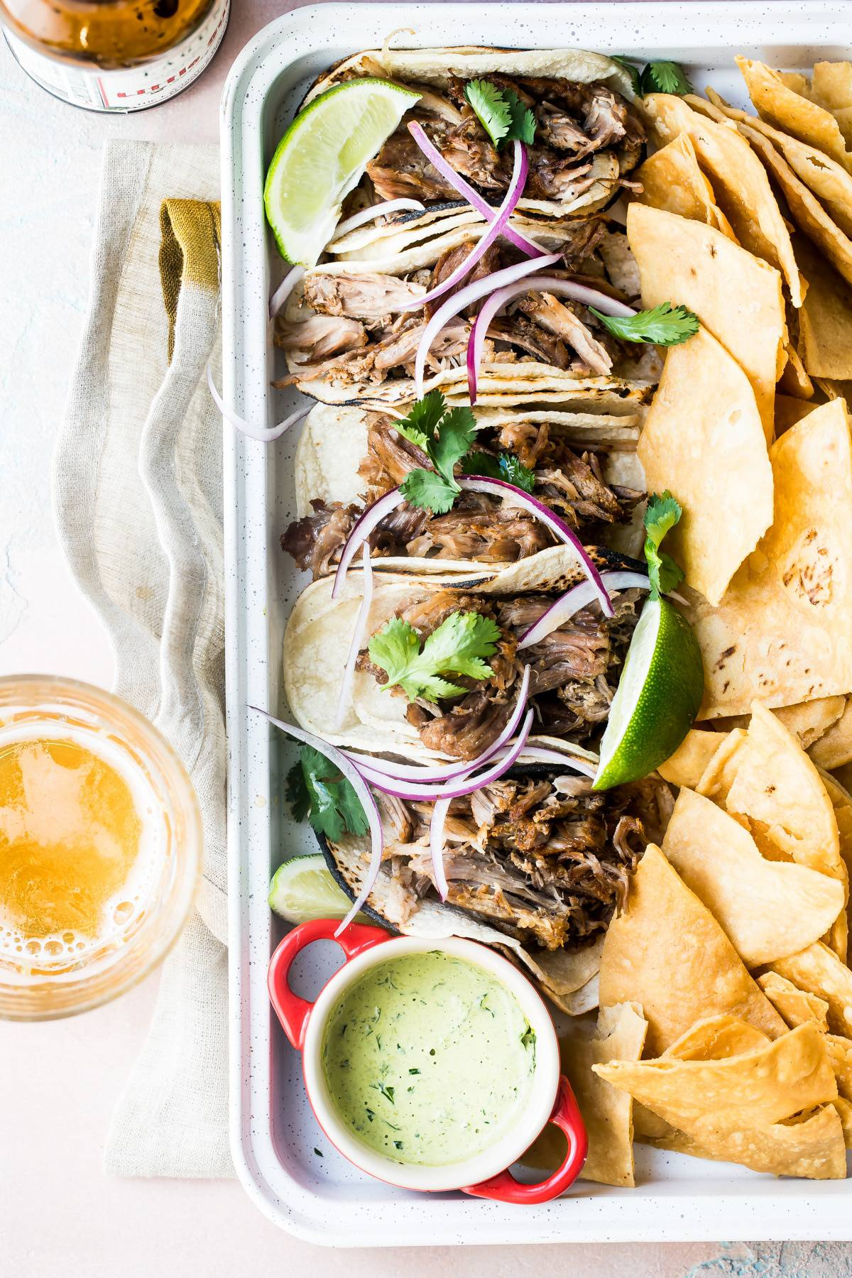 carnitas tacos on a plate with chips