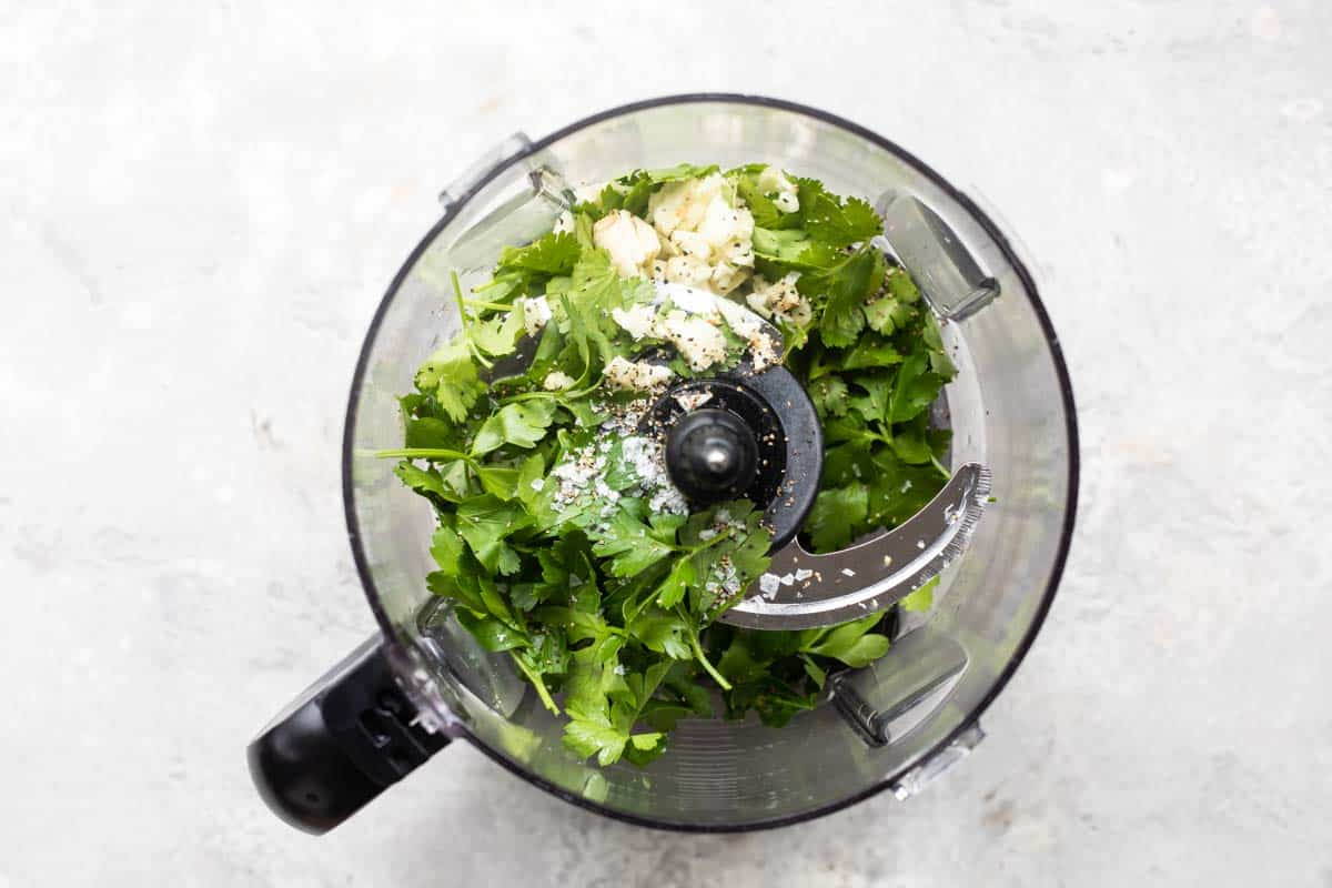 making Chimichurri sauce in a food processor