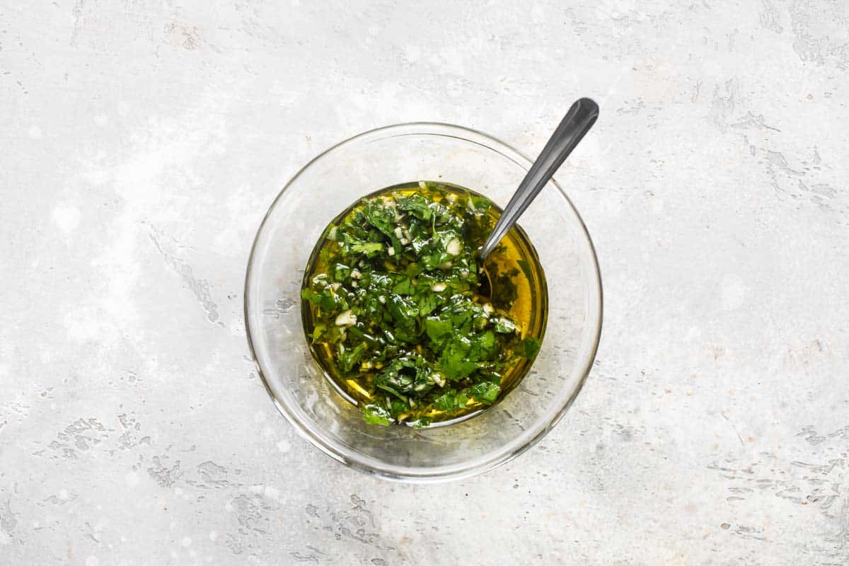 completed Chimichurri sauce with olive oil in a bowl