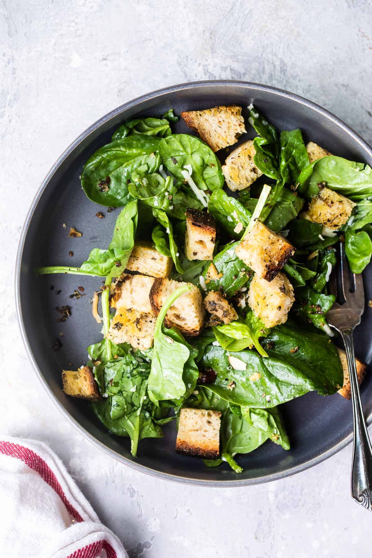 homemade croutons on top of a salad